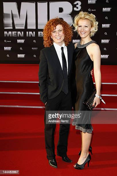 Lucy Diakovska and guest arrive for the Men In Black 3 Germany Premiere at O2 World on May 14 2012 in Berlin Germany