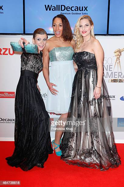 Lucy Diakovska Nadja Benaissa and Sandy Moelling attend the Goldene Kamera 2015 on February 27 2015 in Hamburg Germany