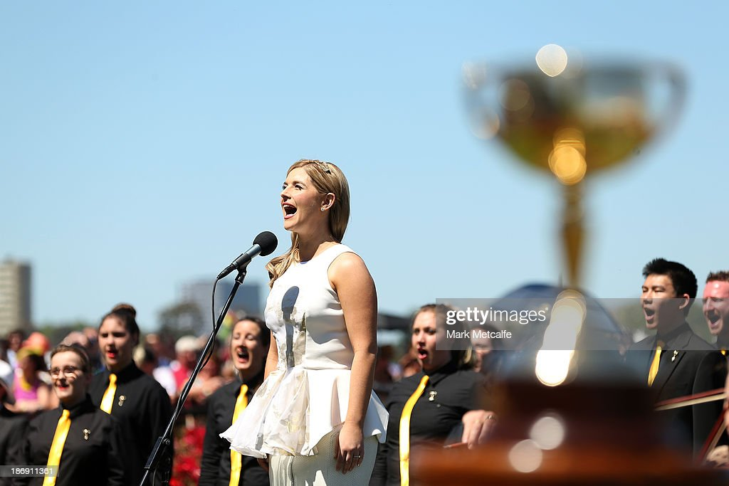 Lucy Durak sings the National Anthem ahead of the running of the Emirates Melbourne Cup during Melbourne Cup Day at Flemington Racecourse on November 5, 2013 in Melbourne, Australia.