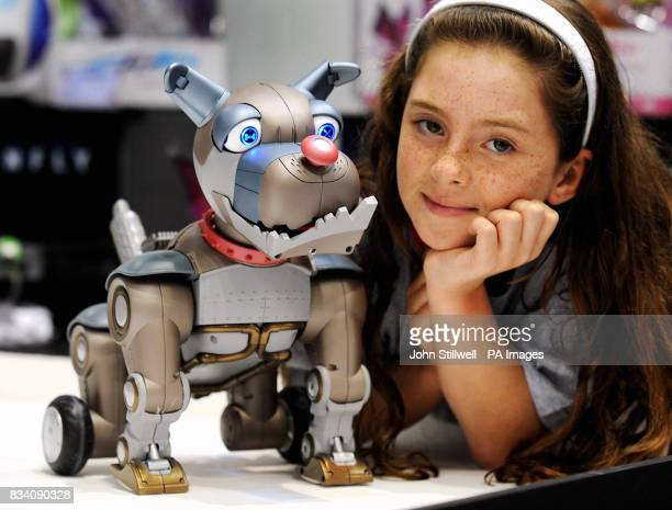 Lucy Emes of Hemel Hempstead with Wrex the Dawg which is made by WowWee Robotic toys at the 2008 Toy Fair at ExCel Exhibition Centre East London