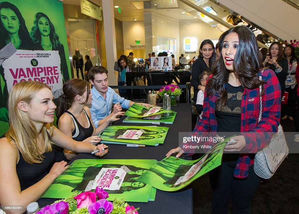 Lucy Fry and Zoey Deutch and Dominic Sherwood sign books and posters for Vampire Academy fans at Westfield San Francisco Centre on January 31, 2014 in San Francisco, California.