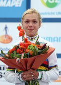 Lucy Garner of Great Britain stands on the podium after winning the Junior Women's Road Race for a second year on day six of the UCI Road World...
