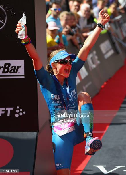 Lucy Gossage of Great Britain celebrates after winning the Women's race during Ironman UK on July 16 2017 in Bolton England