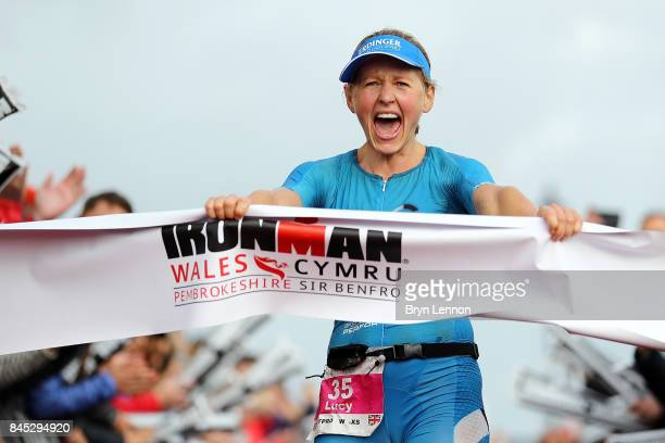 Lucy Gossage of Great Britain celebrates winning IRONMAN Wales on September 10 2017 in Tenby Wales