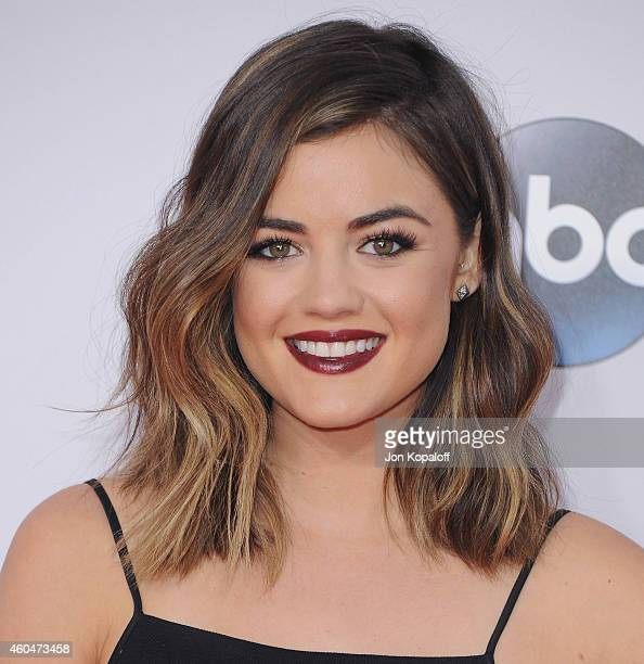 Lucy Hale arrives at the 2014 American Music Awards at Nokia Theatre LA Live on November 23 2014 in Los Angeles California