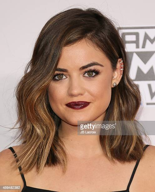 Lucy Hale attends the 2014 American Music Awards at Nokia Theatre LA Live on November 23 2014 in Los Angeles California