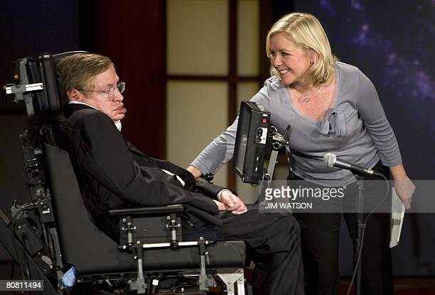 Lucy Hawking touches her father Professor Stephen Hawking as they give a lecture entitled 'Why We Should Go Into Space' during the 50 Years of NASA...