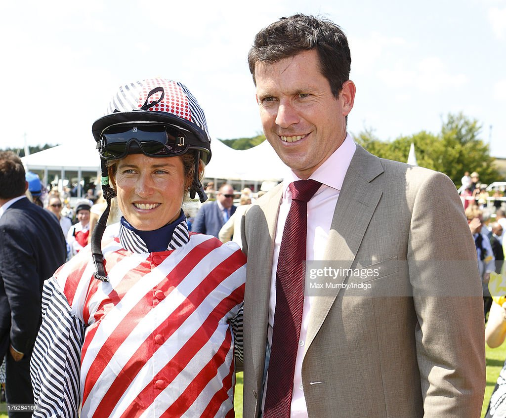 Lucy Henman and <a gi-track='captionPersonalityLinkClicked' href=/galleries/search?phrase=Tim+Henman&family=editorial&specificpeople=167277 ng-click='$event.stopPropagation()'>Tim Henman</a> seen in the parade ring prior to Lucy Henman riding in the charity race on Ladies Day of Glorious Goodwood at Goodwood Racecourse on August 1, 2013 in Chichester, England.