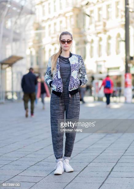 Lucy Jakobi wearing a grey jumpsuit jacket with floral print white sneaker on March 24 2017 in Berlin Germany