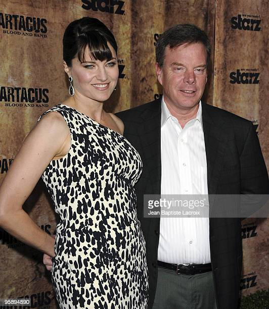 Lucy Lawless and executive producer Rob Tapert arrive at the Starz original TV series 'Spartacus Blood and Sand' at Billy Wilder Theater on January...