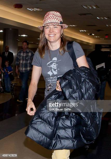 Lucy Lawless is seen at Los Angeles International Airport on March 10 2013 in Los Angeles California