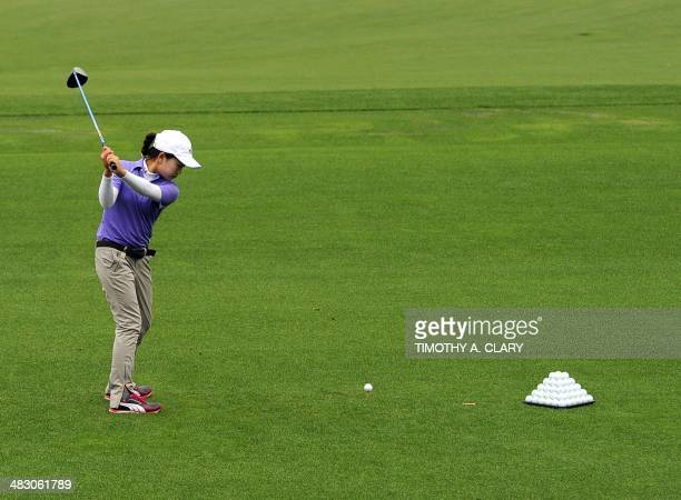 Lucy Li from Redwood City California hits her drive during the National Finals of the 2014 Drive Chip and Putt Championships April 6 2014 at Augusta...