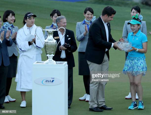 Lucy Li of the United States is presented with the low amateur trophy by Kevin Hopkins The Executive Director of the ANA Inspiration at the...