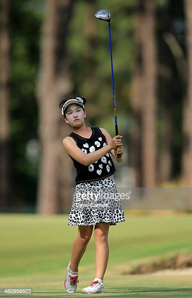 Lucy Li of the USA the 11 year old amateur plays her tee shot to the par 4 18th hole during the second round of the 69th US Women's Open at Pinehurst...