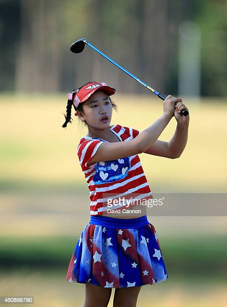 Lucy Li of the USA who is only 11 years old follows her second shot at the par 4 16th hole during the first round of the 69th US Women's Open at...