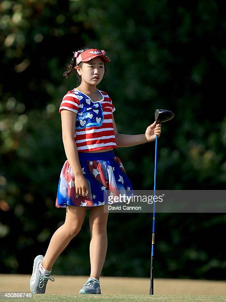 Lucy Li of the USA who is only 11 years old follows her tee shot at the par 4 16th hole during the first round of the 69th US Women's Open at...