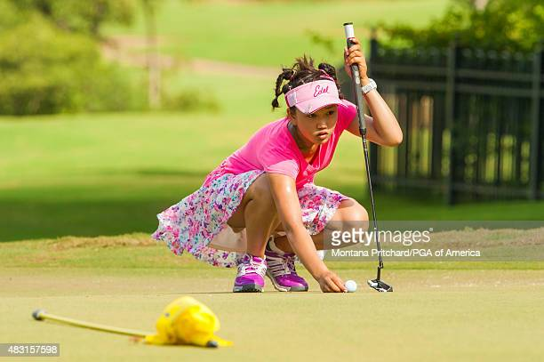 Lucy Li reads her putt on the seventh hole during the Final Round of the 40th PGA Junior Championship at The Miramont Country Club on August 6 2015...