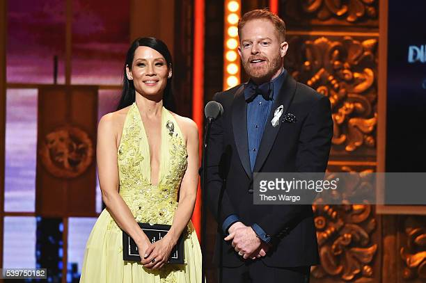 Lucy Liu and Jesse Tyler Ferguson present an award onstage during the 70th Annual Tony Awards at The Beacon Theatre on June 12 2016 in New York City