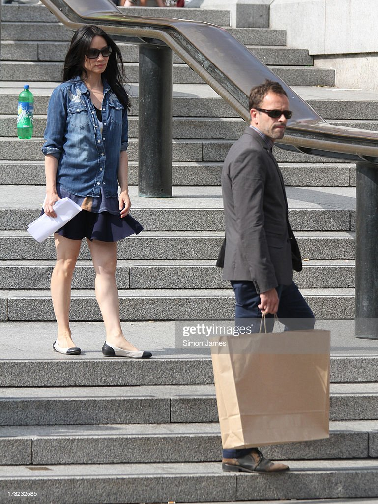 Lucy Liu and Jonny Lee Miller sighting on set filming Elementary on July 10, 2013 in London, England.