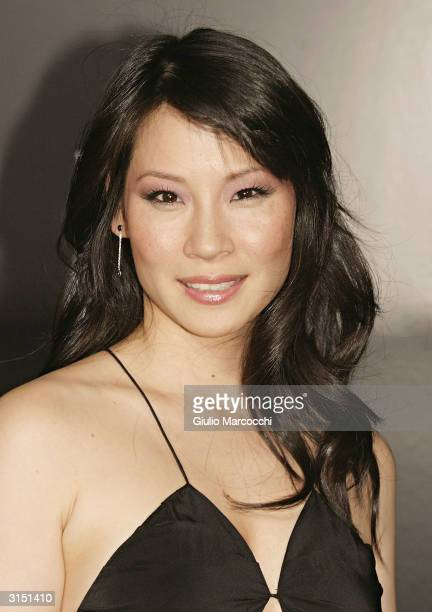 Lucy Liu arrives at the Rodeo Drive Walk of Style Event Honoring Tom Ford on March 28 2004 in Beverly Hills California