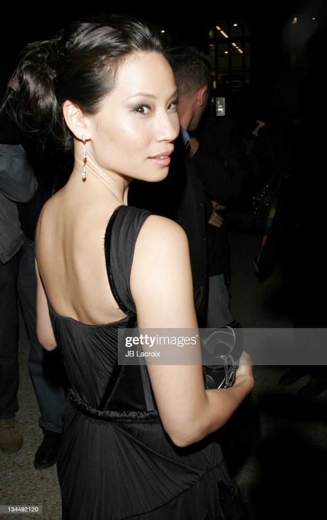 Lucy Liu during Paris Fashion Week - Pret a Porter Spring/Summer 2006 - Christian Dior - Arrivals at Grand Palais in Paris, France.