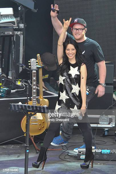 Lucy Liu performs with The Bullitts on stage during The Big Chill Festival 2011 at Eastnor Castle Deer Park on August 6 2011 in Ledbury United Kingdom