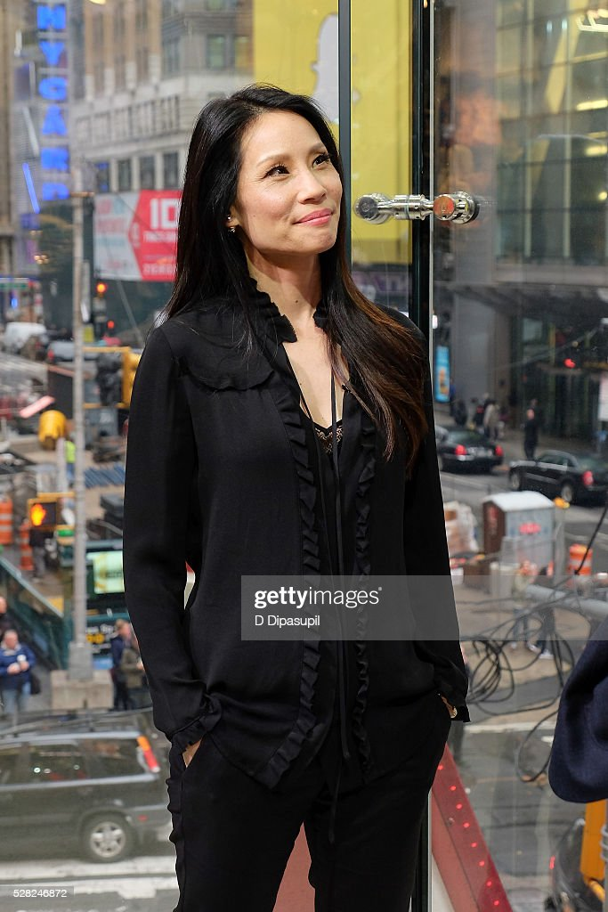 <a gi-track='captionPersonalityLinkClicked' href=/galleries/search?phrase=Lucy+Liu&family=editorial&specificpeople=201874 ng-click='$event.stopPropagation()'>Lucy Liu</a> visits 'Extra' at their New York studios at H&M in Times Square on May 4, 2016 in New York City.