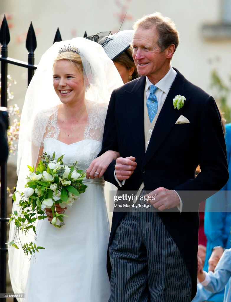 Lucy Meade accompanied by her father Richard Meade arrives for her wedding to Charlie Budgett at the church of St Mary the Virgin, Marshfield on March 29, 2014 in Chippenham, England.