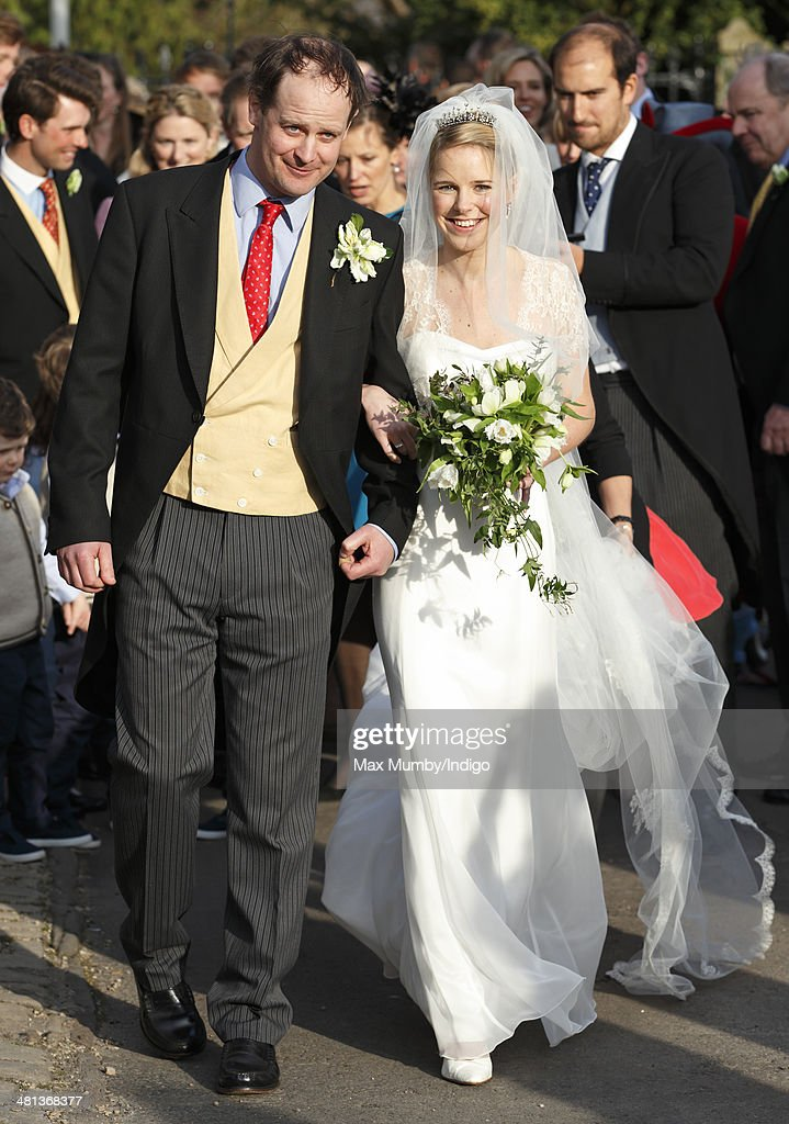 Lucy Meade and Charlie Budgett leave the church of St Mary the Virgin, Marshfield after their wedding on March 29, 2014 in Chippenham, England.