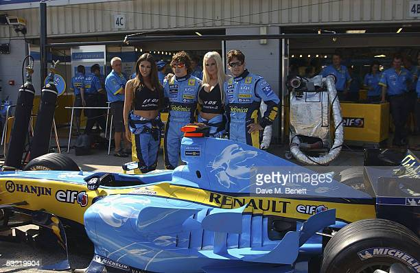 Lucy Pinder Fernando Alonso Michelle Marsh and Giancarlo Fisichella attend the Formula One British Grand Prix at Silverstone on July 10 2005 in...