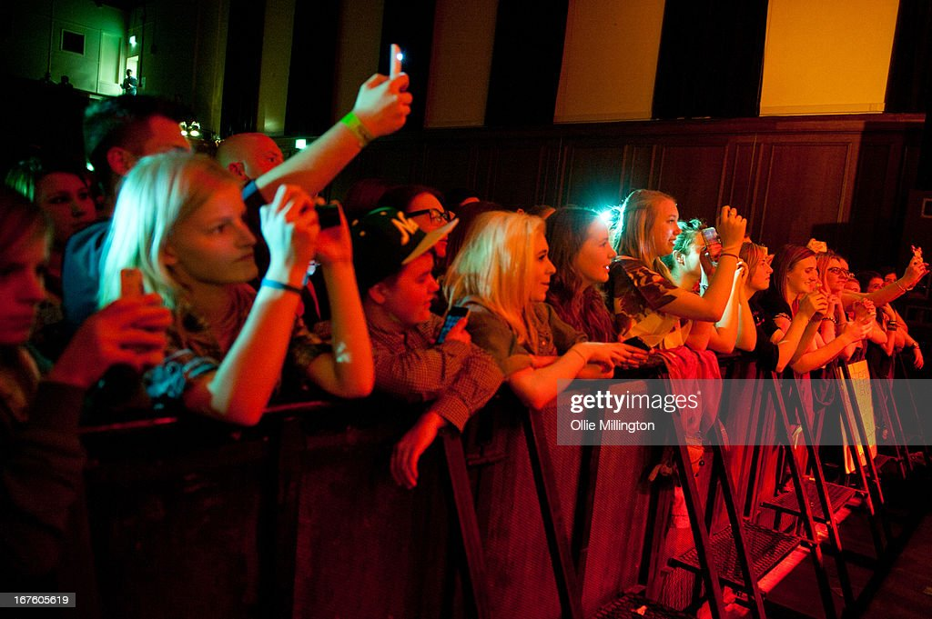 Lucy Spraggan fans in the front row watch on as she performs on stage during the second night of her sold out April/May 2013 UK tour at o2 Academy on April 26, 2013 in Leicester, England.