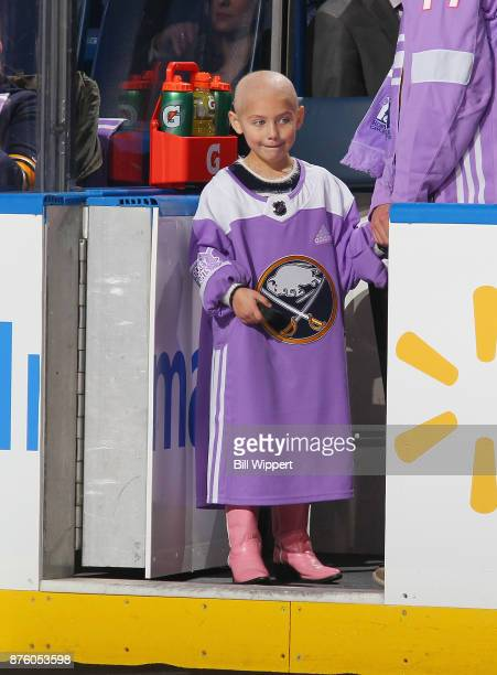 Lucy takes part in pregame ceremonies on Hockey Fights Cancer Night before an NHL game between the Buffalo Sabres and the Carolina Hurricanes on...