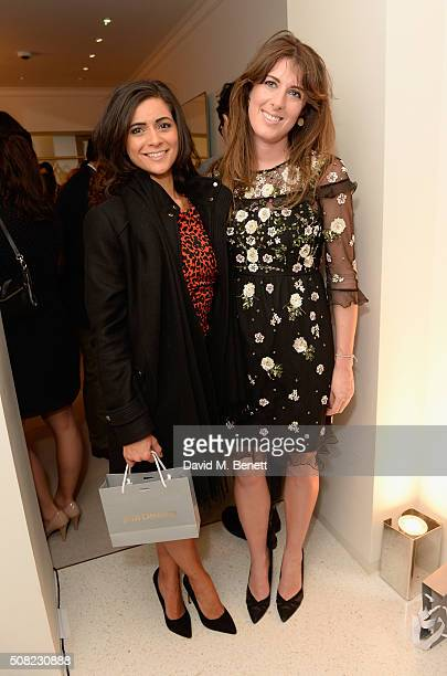 Lucy Verasamy and Anna Bance attend the opening of the new JM Davidson store in Mount Street Mayfair on February 3 2016 in London England