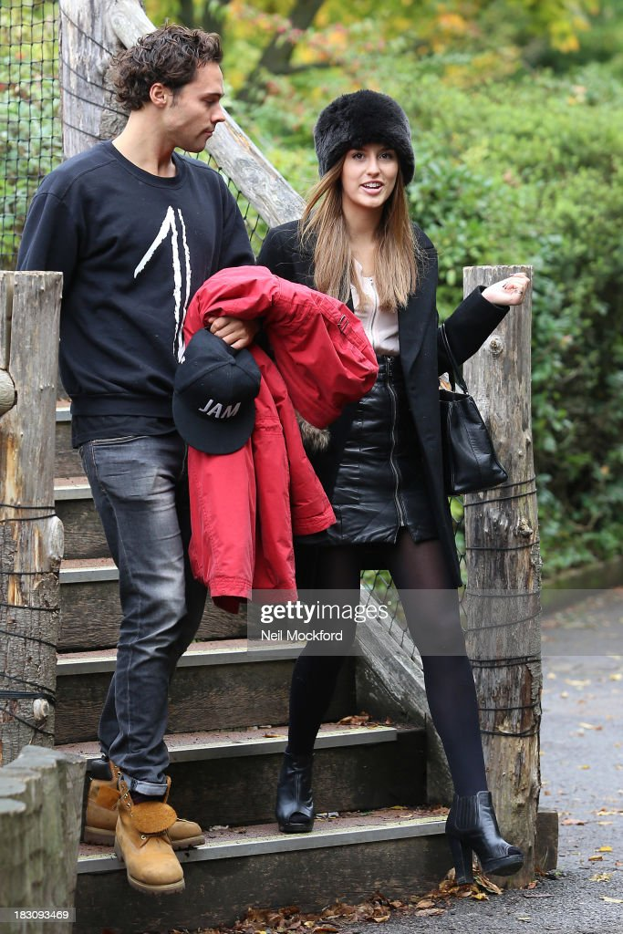 <a gi-track='captionPersonalityLinkClicked' href=/galleries/search?phrase=Lucy+Watson&family=editorial&specificpeople=10044172 ng-click='$event.stopPropagation()'>Lucy Watson</a> and Andy Jordan are pictured feeding the giraffes and watching the penguins at ZSL London Zoo on October 4, 2013 in London, England.