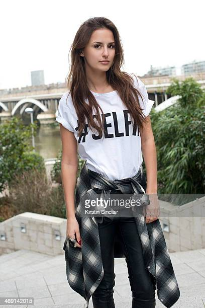 Lucy Watson is pictured wearing a River Island Shirt a French Connection Tshirt a Regal Rose ring and a ring from Lucy's brand 'Creature' on February...