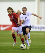 Lucy Whipp of England challenged by Yngvild Kaspersen of Norway during the England v Norway Under 19 Women's International match at St Georges Park...