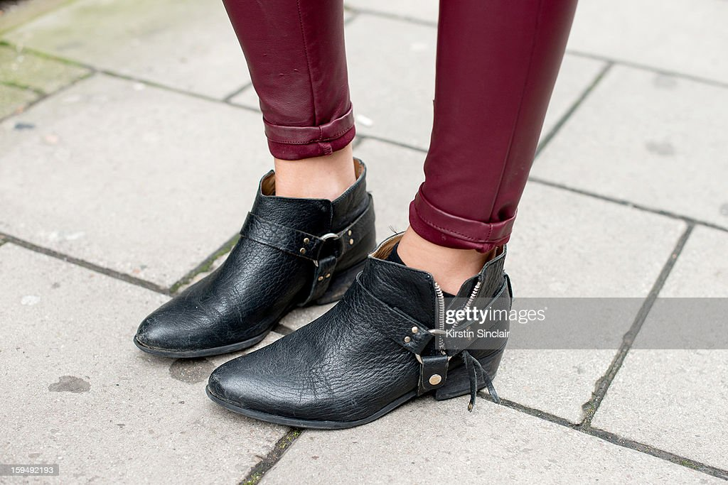 Lucy Williams Fashion Researcher and Blogger at Stylus media group wearing Zara boots and H and M jeans on day 1 of London Mens Fashion Week Autumn/Winter 2013, on January 07, 2013 in London, England.