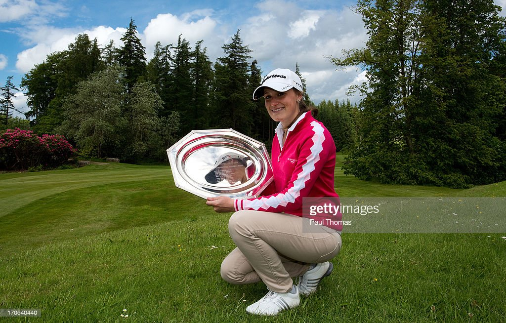 Lucy Williams of Mid Herts Golf Club poses with the trophy after the final round of the Glenmuir WPGA Professional Championship on the Hunting Course at De Vere Slaley Hall on June 14, 2013 in Hexham, England.