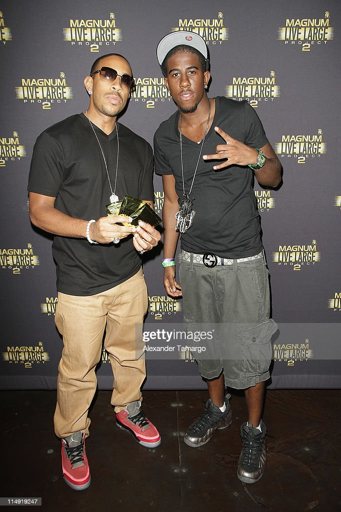 Ludacris (L) and guest attend Magnum Condoms & Ludacris Wrap Up The Magnum Live Large Project 2 In Miami at Cameo nightclub on May 28, 2011 in Miami Beach, Florida.