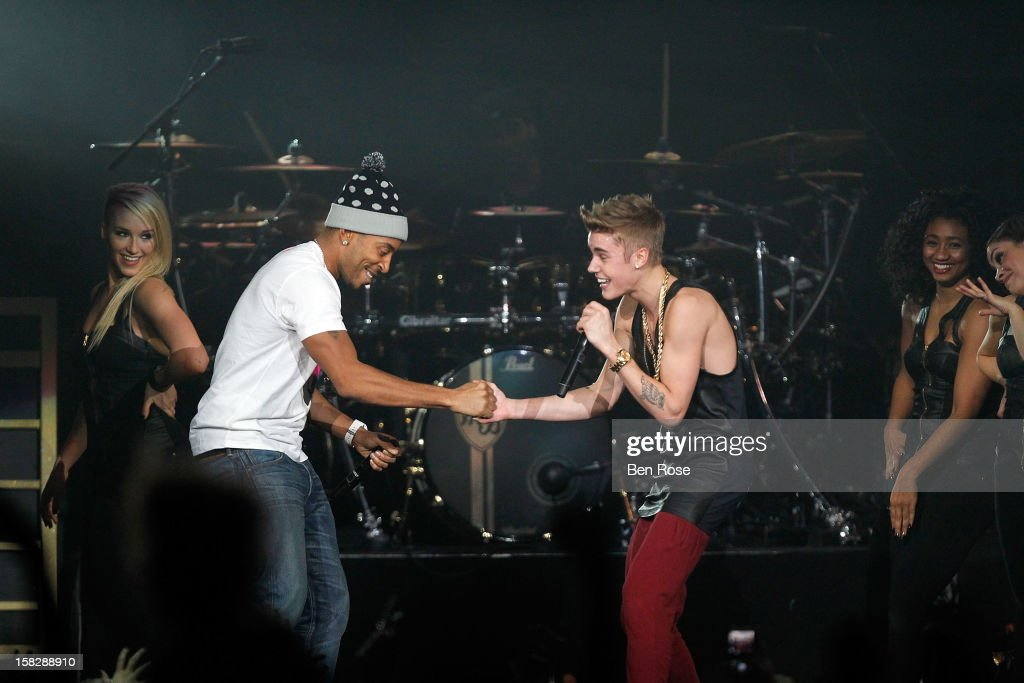 Ludacris and Justin Bieber perform onstage during Power 96.1's Jingle Ball 2012 at the Philips Arena on December 12, 2012 in Atlanta.