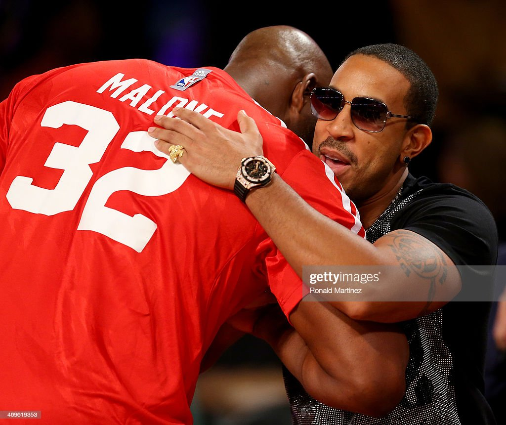 Ludacris hugs Western Conference All-Star Legend Karl Malone during the Sears Shooting Stars Competition 2014 as part of the 2014 NBA All-Star Weekend at the Smoothie King Center on February 15, 2014 in New Orleans, Louisiana.