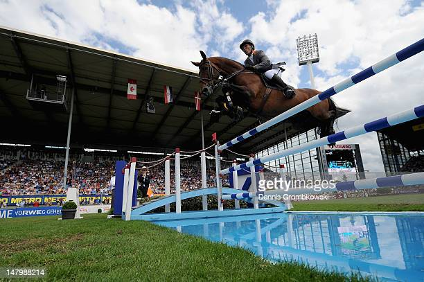 Ludger Beerbaum of Germany and his horse Chaman compete in the Prize of AachenMuenchener jumping competition during day five of the 2012 CHIO Aachen...
