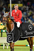Ludger Beerbaum of Germany riding Casello during the award ceremony for the Mercedes Benz Nations Cup on July 14 2016 in Aachen Germany