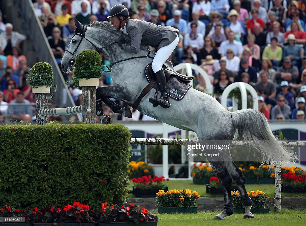 <a gi-track='captionPersonalityLinkClicked' href=/galleries/search?phrase=Ludger+Beerbaum&family=editorial&specificpeople=607707 ng-click='$event.stopPropagation()'>Ludger Beerbaum</a> rides on Codex One and during the Rolex Grand Prix jumping competition during the 2013 CHIO Aachen tournament on June 30, 2013 in Aachen, Germany.