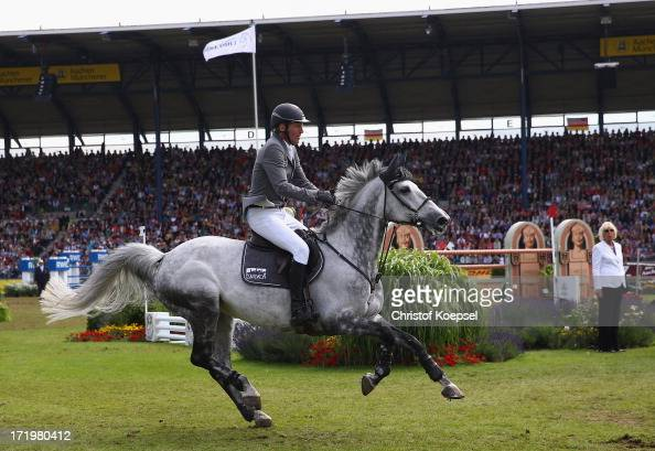 Ludger Beerbaum rides on Codex One and during the Rolex Grand Prix jumping competition during the 2013 CHIO Aachen tournament on June 30 2013 in...