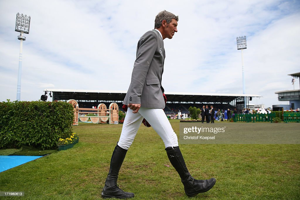 Ludger Beerbaum walks over the parcour prior to the Rolex Grand Prix jumping competition during the 2013 CHIO Aachen tournament on June 30, 2013 in Aachen, Germany.