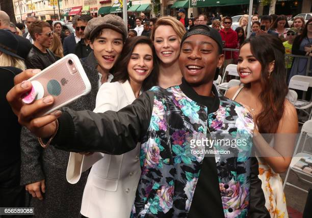 Ludi Lin Naomi Scott Elizabeth Banks RJ Cyler and Becky G take a selfie at a Star Ceremony on The Hollywood Walk Of Fame Honoring Haim Saban on March...