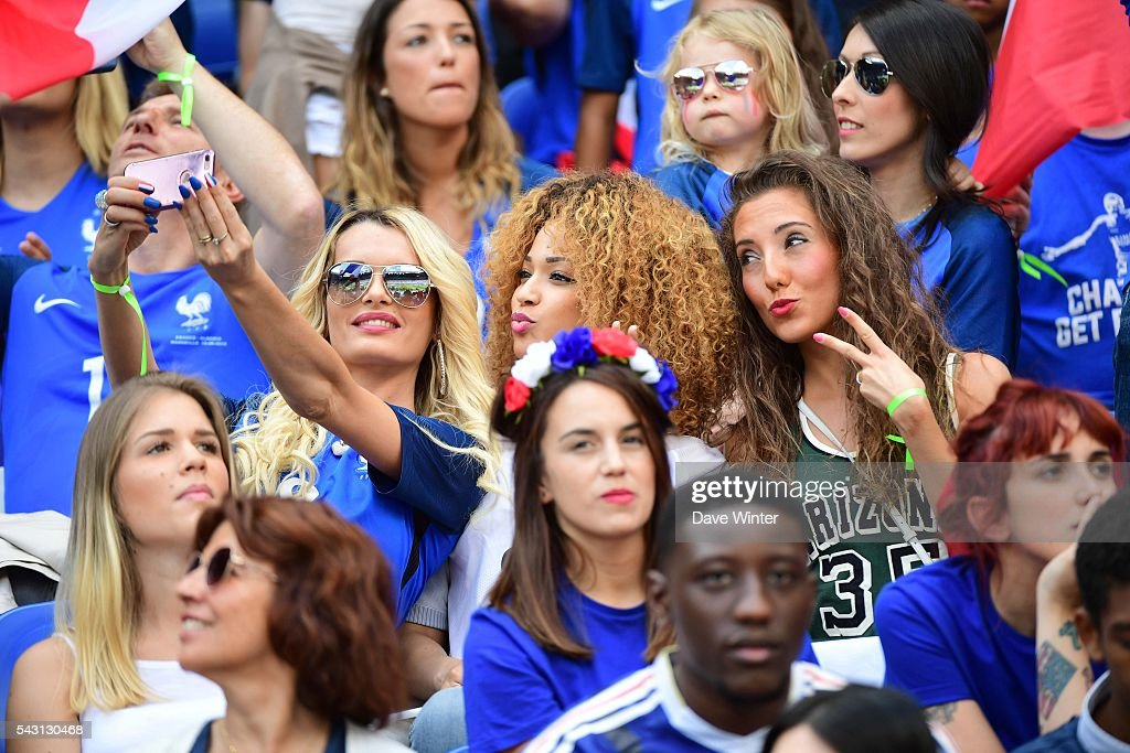 Ludivine Payet (wife of Dimitri Payet of France), Sephora Coman (wife of Kingsley Coman of France) and Tiziri Digne (wife of Lucas Digne of France) during the European Championship match Round of 16 between France and Republic of Ireland at Stade des Lumieres on June 26, 2016 in Lyon, France.
