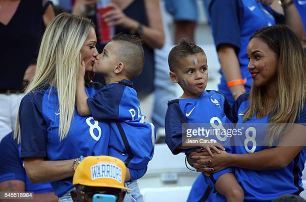 Ludivine Payet wife of Dimitri Payet and their sons Milan Payet and Noa Payet attend the UEFA Euro 2016 semifinal match between Germany and France at...