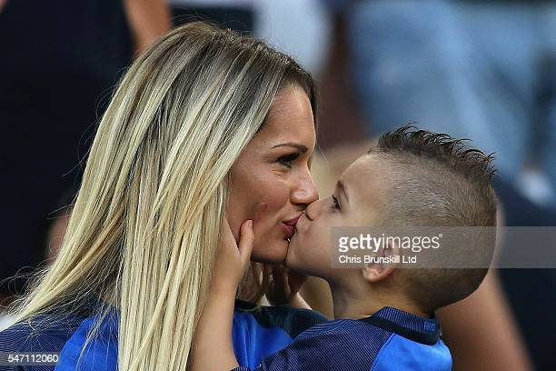 Ludivine Payet wife of Dimitri Payet of France kisses her child prior to the UEFA Euro 2016 Semi Final match between Germany and France at Stade...